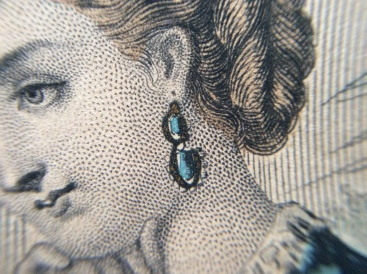 Lovely fine details on the genuine engraving, gold paint on the earrings.